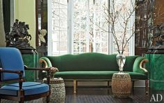 Minton garden stools stand before a gilt-wood sofa covered in a velvet from Stark in the salon; the armchair is by Jacob Frères.