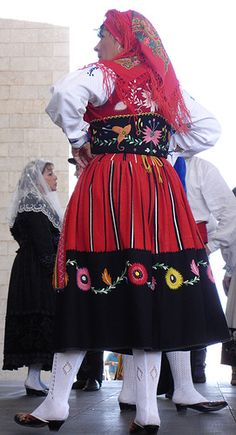 Portugal:    Portuguese costume reveals a cultural and ethnic link to their Spanish brothers, with slight divergences to reflect Portugal's long and distinct history. It is, interestingly, similar in many ways to Basque dress.