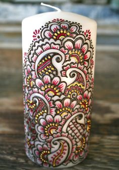 Henna Style Painted Candle, Chocolate Brown, Magenta, and Gold, Ivory Pillar Candle. $30.00, via Etsy.