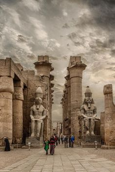 Colossal statues of Ramses II Dynasty) wearing the Pshent crown flank the entrance. Luxor Temple, Luxor Egypt, Egyptian Pharaohs, Egyptian Art, Ancient Egypt, Ancient History, Monuments, Indian Temple Architecture, Photography Ideas At Home