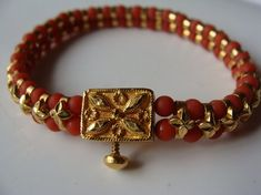 Enhance your ethnic look with this stunning coral gold bracelet Indian Wedding Jewelry, Indian Jewelry, Bridal Jewelry, Ethnic Jewelry, Gold Bangles Design, Jewelry Design, Designer Bangles, Designer Jewellery, Latest Jewellery