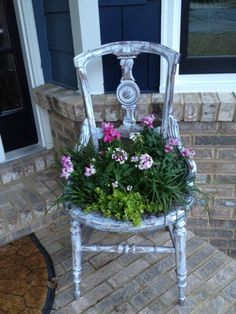Old vintage chair turned into a flower planter. Replace the seat with chicken wire and fill!