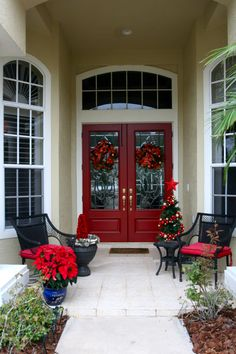 Lovely Christmas Decoration In House Entry Space With Red Front Door And Beautiful Wreaths