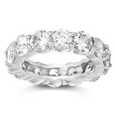 """""""Cubic Zirconia Stackable Eternity Band Ring"""" Perfect alone, perfect with a partner, this cubic zirconia eternity band ring will quickly become your favorite accessory. It makes a great little accent-piece with over 9 carats of diamond-like cubic zirconia, or stack several to add some real spark to your style."""