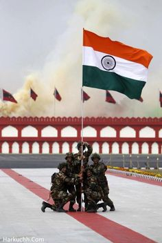 2) Indian army holding Indian national flag