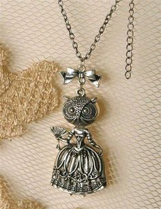 "MADEMOISOWL NECKLACE - $19.95  A demure bird has fashion sense. The chic pendant is a wise investment assured to accessorize winter sweaters. 18"" chain, 2"" pendant."
