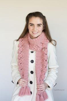 Add some feminine charm to your wardrobe this winter in the form of this Pink Lemonade scarf, which features a unique design running along the centre and some fluffy tassels! This scarf was designed with cool evenings in mind, making it the perfect accessory to throw on for when you need some extra layers to keep you warm on those chillier days.