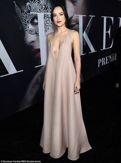 Dressed for the occasion: Dakota Johnson arrived to the Los Angeles premiere of Fifty Shad...