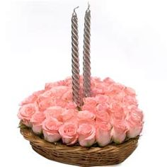 A bulk of 50 pink roses with silver candles meant loyalty to ur partner Order now