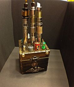 Steampunk Ecig Mod Stand/Holder by JaysixArtwerks on Etsy, $120.00 Please follow our boards for the Best in Vaping.