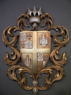 this is an exmaple of a vintage heraldry sign or badge. I love how this is designed and put together.
