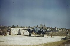 Resting in blast-wall protected Dispersal Point 125 at Luqa, a Bristol Beaufort Mark II of No 39 Squadron, Royal Air Force is attended to by ground crew. Malta June 1943