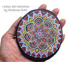 Colorful Mandala #paintedstones https://www.facebook.com/ISassiDelladriatico