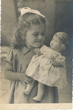 1952 CUTE KID GIRL CHILD with ANTIQUE DOLL vintage old photo original