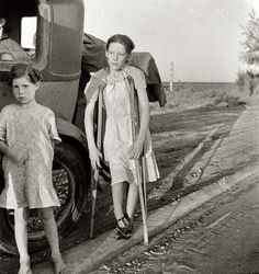 End of the Road: June 1935. Children of Oklahoma drought refugees on highway near Bakersfield, California. Family of six; no shelter, no food, no money and almost no gasoline. The child has bone tuberculosis. Medium-format nitrate negative by Dorothea Lange for the Resettlement Administration.
