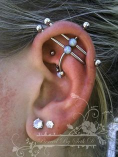 ear project by Portland-based piercing artist Seth Dietz   double industrial/rook piercing