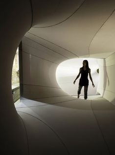 Sophia Chang installs stretchy fabric tunnels through a gallery