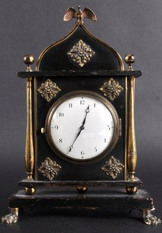 A FRENCH SEDAN TYPE CLOCK in a mahogany brass bound case with claw feet. <3ADORE THIS CLOCK<3 @