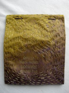 Susan Mills Artist Books:     Publisher's Binding: Garden Ledger  2011  edition of 3 unique books  9 x 7.5 x .5 inches/ 22.5 x 19 x 1.5 cm  vegetable parchment text block; kozo cover  with plant dyes (logwood; lotus or sweet gum);  hot gold stamping; 'gold' thread.