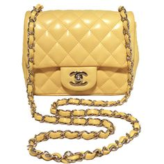 Chanel Yellow Lambskin Mini Classic Flap Shoulder Bag (69,210 MXN) ❤ liked on Polyvore featuring bags, handbags, shoulder bags, quilted handbags, yellow purse, mini purses, yellow handbag and chanel shoulder bag