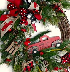 Red Truck Wreath. A charming red truck that is headed home for Christmas. This design will go with any décor and look fabulous inside or out of the home. Created using a rustic grapevine wreath base. Filled with winter pines, evergreen and snow tipped pine. The red truck is the star of