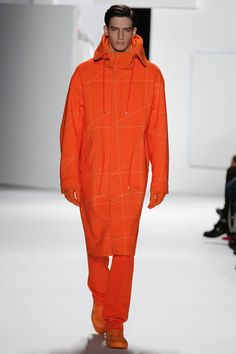 Lacoste Fall 2013 Menswear - Full set of orange colored hoodie and pants. I chose this design because of the lovely orange colour. The hoodie is quite unique as it is longer than regular ones. 2013 Fall trend for menswear would be something that's long to the knee cap area.