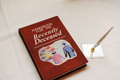 """A blank version of """"The Handbook for the Recently Deceased"""" from Tim Burton's """"Beetlejuice"""" makes a clever guest book for a vintage Halloween-infused October wedding."""