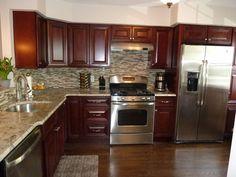 ... appliances, granite counter tops, tile back splash, mahogany cabinets