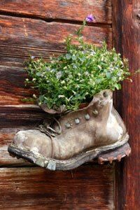 A variety of boots and shoes would make for an interesting display on  a fence!!