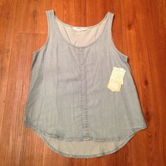 Light jean tank top Brand new with tag. Purchased from Dilliards. Retail price $39. Size medium, fits a women's size 4/6. Has buttons down the front but they are one decoration, shirt does not unbutton. Celebrity Pink Tops Tank Tops