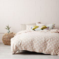 A stylish quilt cover in an easy-to-live-with colour palette and design. A retro spot adorns one side while a blush circle cut out print features on the reverse Tribal Bedding, Greenhouse Interiors, Boutique Design, Awesome Bedrooms, Quilt Cover, Soft Furnishings, Dorm Room, Home Goods, Quilts