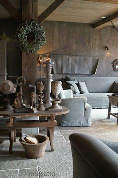 This wood & stone living room filled w/ neutral colors is the epitome of rustic design. From the elegant yet simple table to the wreath, we adore everything about this interior! Dark Interiors, Rustic Interiors, Rustic Style, Rustic Decor, Rustic Design, Deco Champetre, Interior Decorating, Interior Design, Decorating Ideas