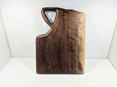 Hand Carved Walnut wood cutting board, cheese board, or serving board by Grain Momentum Woodworking.