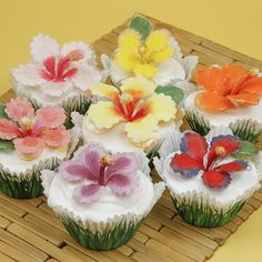 Crystal Hibiscus Cupcakes Not your garden variety cupcakes! Exotic Hibiscus blooms in hot colors adorn these tropical treats!