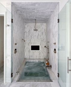 A beautiful spa bathtub inside of the shower #tilebathtub