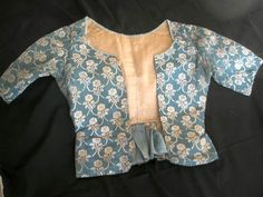 """A blue and cream silk bodice with a floral design c. 1780. It is lined in brown linen, and all hand-stitched. The bodice is in excellent condition with a few very minor alterations, and slightly shortened sleeves.  Measurements: Around waist 24"""" (61cm). Shoulder to waist 17"""" (43cm) - my note: possibly altered in the early 19th c? http://www.ebay.co.uk/itm/DELIGHTFUL-ANTIQUE-FRENCH-SILK-BODICE-IN-BLUE-AND-CREAM-FLORAL-DESIGN-ca-1780-/111148789852"""