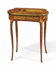 A LOUIS XV-LOUIS XVI TRANSITIONAL TULIPWOOD AND SYCAMORE WRITING-TABLE, THE MARQUETRY TOP IN THE TASTE OF DAVID ROENTGEN, CIRCA 1760