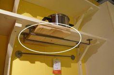 Install IKEA rails under a shelf to store cutting boards.