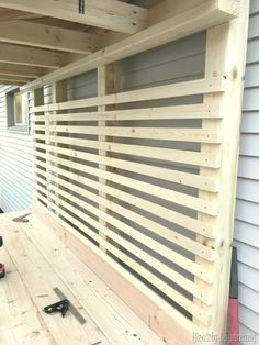 Slats on giant potting bench for hanging things! {Reality Daydream}