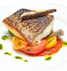 Griddled Sea Bass with Stuffed Courgettes, Tomatoes , Olives and Basil - William Drabble @ Great British Chefs Mediterranean Sea Bass Recipe, Fish Recipes, Seafood Recipes, Great British Chefs, Fish Dishes, Fish And Seafood, Food Presentation, Food Plating, Gastronomia