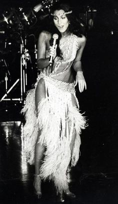 "Cher onstage in 1979. The icon opines: ""Until you're ready to look foolish, you'll never have the possibility of being great."""