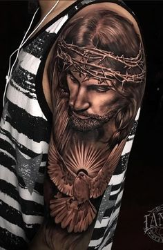 70 Incredible Religious Tattoos You To Get Inspired Forearm Sleeve Tattoos, Bicep Tattoo, Best Sleeve Tattoos, Tattoo Sleeve Designs, Hand Tattoos, Religious Tattoos For Men, Religious Tattoo Sleeves, Religion Tattoos, Jesus Tattoo Sleeve