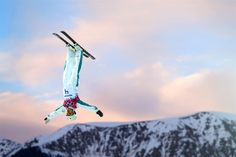 Lydia Lassila of Australia competes in the freestyle skiing ladies' aerials qualification on day seven of the Sochi 2014 Winter Olympics at Rosa Khutor Extreme Park on Feb. 14 in Sochi. Olympic Sports, Olympic Games, Lydia Lassila, Ski Diving, Cool Pictures, Cool Photos, Freestyle Skiing, Riders On The Storm, Best Sunset