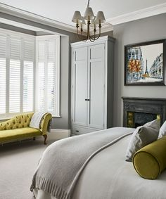 gray bedroom with pop of color A modern cityscape (by Nigel Cooke at Wyecliffe Galleries) and lime-green accents lift the neutral palette in this comfortable bedroom, Gray Bedroom, Home Decor Bedroom, Modern Bedroom, Bedroom Furniture, Modern Victorian Bedroom, Bedroom Ideas, Victorian Terrace Interior, Quirky Bedroom, 50s Bedroom