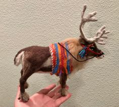 Needle felted Sami reindeer with harness by Julie Kong 2017