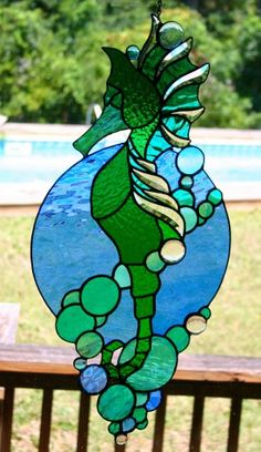 Stained glass beveled seahorse by AGlassMenagerieEtc on Etsy Stained Glass Suncatchers, Faux Stained Glass, Stained Glass Projects, Stained Glass Windows, Mosaic Projects, Stained Glass Patterns Free, Stained Glass Designs, Glass Painting Designs, Glass Wall Art