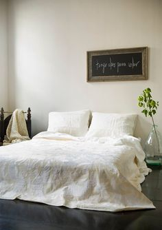 i do love a simple bedroom -- the fabric on the bed is gorgeous