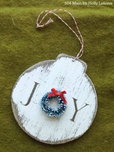Decorate the tree with a sweet handmade JOY ornament adorned with a miniature wreath.