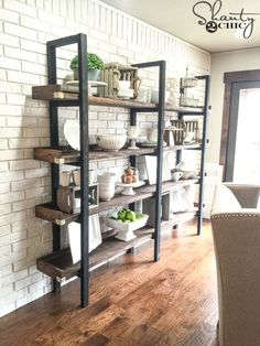 Build a custom DIY Modern Plate Rack for only $95 in lumber! Find the free DIY furniture plans and step-by-step tutorial at www.shanty-2-chic.com .