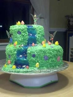 Homemade  Fairy Cake Design: This Fairy Cake Design was created using a 10 inch and 6 inch round cake. I used the large Wilton straws for the supports for the 6 inch layer. I also